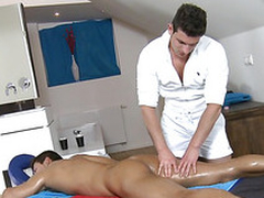 Hot hunk is getting his paper money sucked by gay masseur
